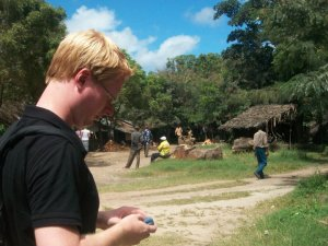 Steven George-Hilley using mobile technology in Kenya